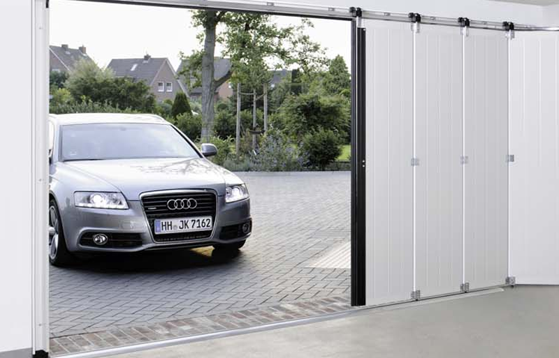 Porte sectionnelle lat rale sac s curit for Porte garage ouverture laterale
